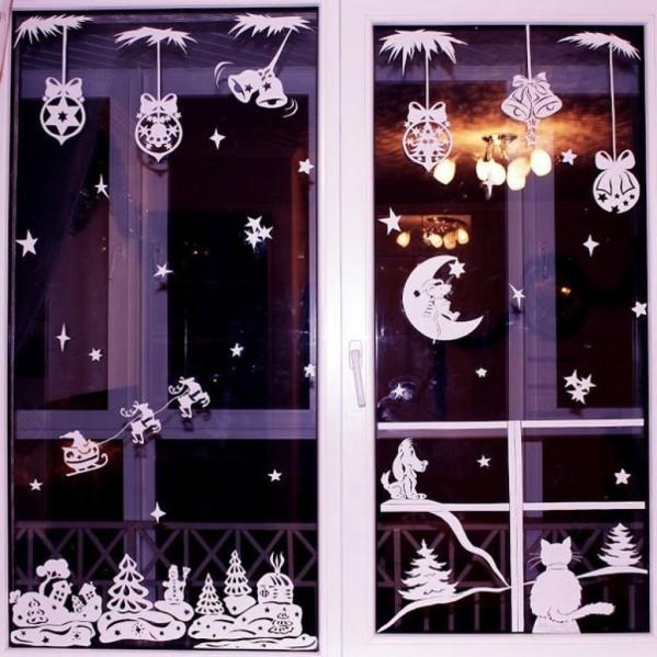 Как красиво украсить окна вытынанками на Новый год